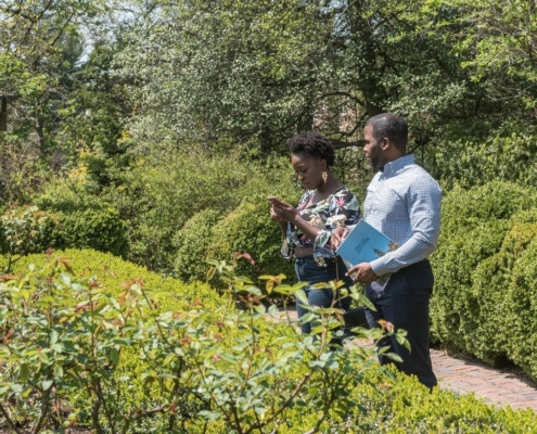 black couple looking at box knot garden