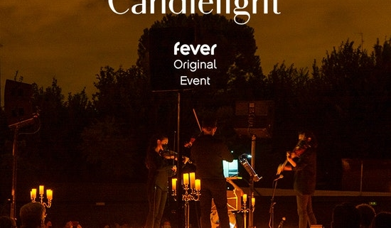 string quartet playing outdoors by candlelight